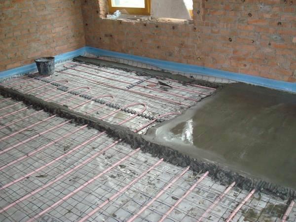 Заливка теплого пола бетонной стяжкой